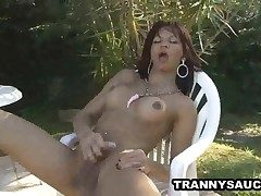 Latina she-creature babe milking on her cock outdoors