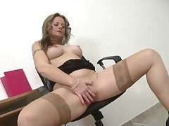 Mummy takes a break at work to masturbate her lusty cell